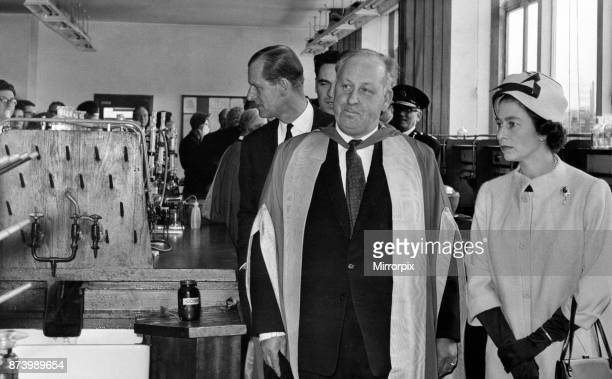 The Queen and the Duke of Edinburgh touring a laboratory of the Haworth Chemistry Building at the University of Birmingham escorted by Prof J C...