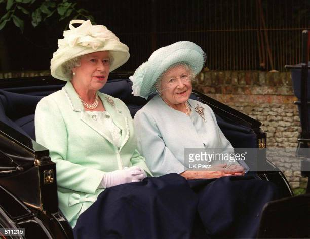 The Queen and the Queen Mother sit in a carriage as they attend a service at Sandringham Church July 22 2001 in Norfolk England Buckingham Palace...
