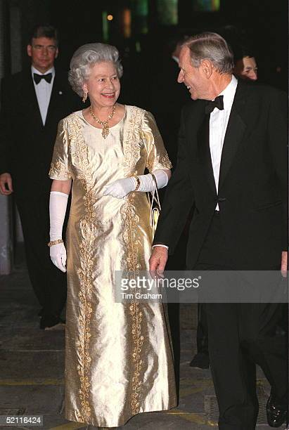 The Queen Arriving For 'the Royal Gala' At The Festival Hall In London To Celebrate Her Golden Wedding Anniversary She Chose A Gold Evening Dress For...