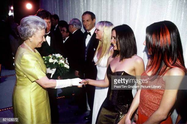 The Queen At The Royal Command Performance At The Victoria Palace Theatre On 1st December 1997 Shaking Hands With Pop Star Victoria Beckham Of The...