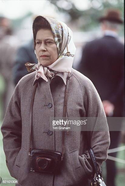 The Queen At The Royal Windsor Horse Show. She Has Her Camera Around Her Neck.