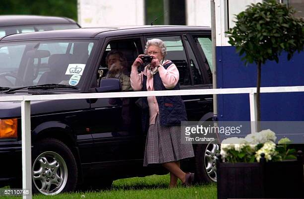 The Queen At The Royal Windsor Horse Show Using Her Own Camera To Take A Photograph Of Her Husband Competingleaning On Her Four Wheel Drive Range...