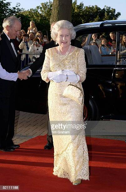 The Queen Attending A Banquet As Guest Of The States Of Guernsey Wearing A Dress Designed By Fashion Designer Sir Hardy Amies