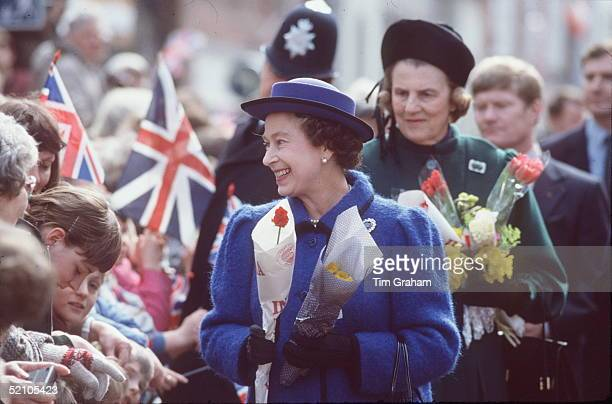 The Queen Attending The Maundy Service At Chichester Cathedral She Is Receiving Flowers During A Walkabout With Her Ladyinwaiting The Duchess Of...