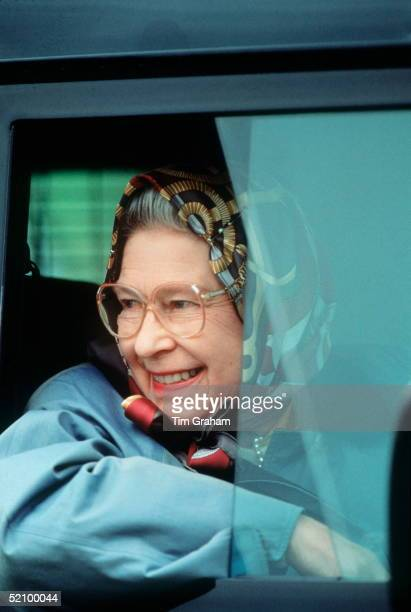 The Queen Driving Herself In A Landrover 4wheel Drive Vehicle In Windsor
