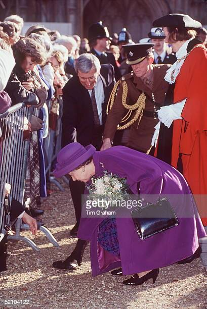 The Queen During A Walkabout In Winchester Picking Up A Camera That Someone From The Crowd Has Dropped