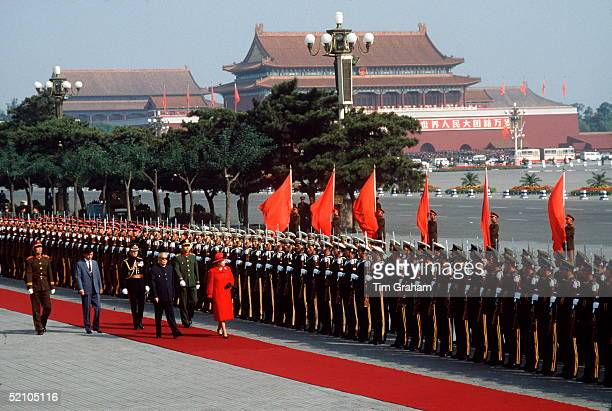 The Queen During An Official Tour Of China Inspecting A Guard Of Honour At Tiananmen Square