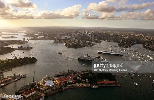 The Queen Elizabeth 2 passenger liner top and the Queen Victoria pass each other as the Victoria leaves Sydney Harbour bound for Brisbane after its...