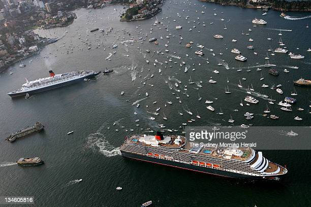 The Queen Elizabeth 2 passenger liner top left and the Queen Victoria pass each other as the Victoria leaves Sydney Harbour bound for Brisbane after...
