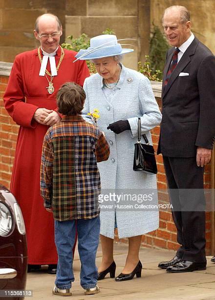 The Queen Elizabeth II accepts a posy of spring flowers from eight year old Zachary McCarthy-Fox as she departs the Easter Sunday service at St...