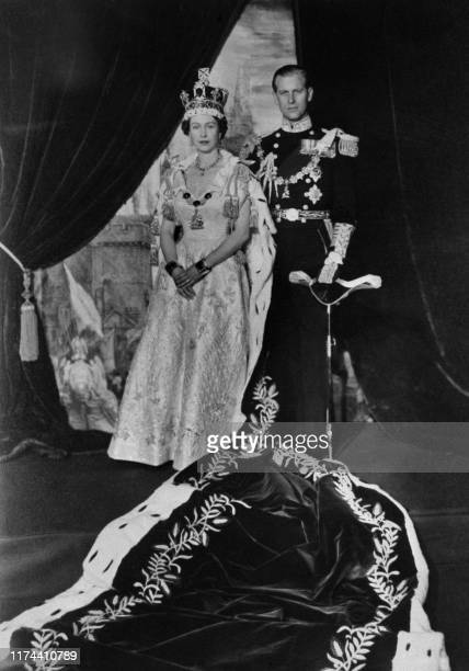 The Queen Elizabeth II and the Prince Philip pose after the Queen's Coronation, 02 June 1953 in Buckingham Palace.