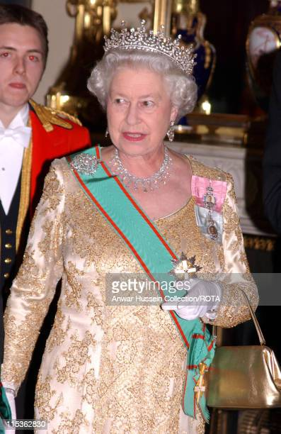 HM The Queen Elizabeth II arrives for a her banquet to welcome the Italian Republic President and his wife Signora Ciampi during their state visit to...
