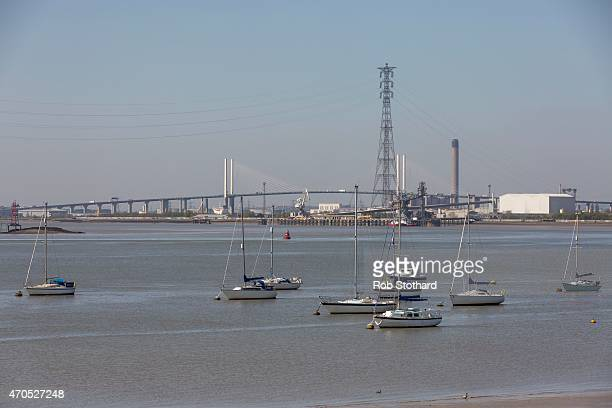 The Queen Elizabeth II bridge is seen beyond boats anchored at Grays beach on April 21 2015 in Grays England The south Essex constituency of Thurrock...