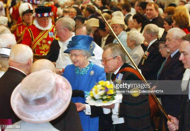 HM The Queen Elizabeth II distributes Maundy Money during the Royal Maundy Service in Wakefield Cathedral Thursday March 24 2005 The Queen gave...