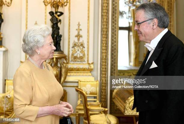 HM The Queen Elizabeth II greets the United States Ambassador to London Mr Robert Holmes Tuttle with his letter of credentials at Buckingham Palace...