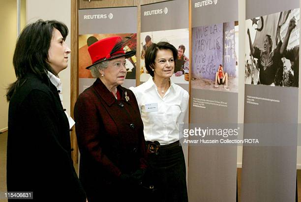 HM The Queen Elizabeth II is shown a photographic exhibition of pictures by Reuters photographer Zohra Bensemra by Reuters' Senior Vice President and...