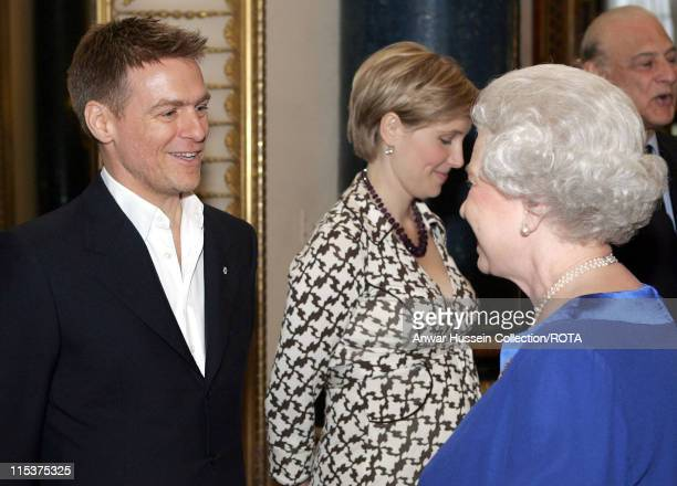 HM The Queen Elizabeth II meets singer and guitarist Bryan Adams at a reception for talented Canadians at Buckingham Palace London Tuesday May 3 2005