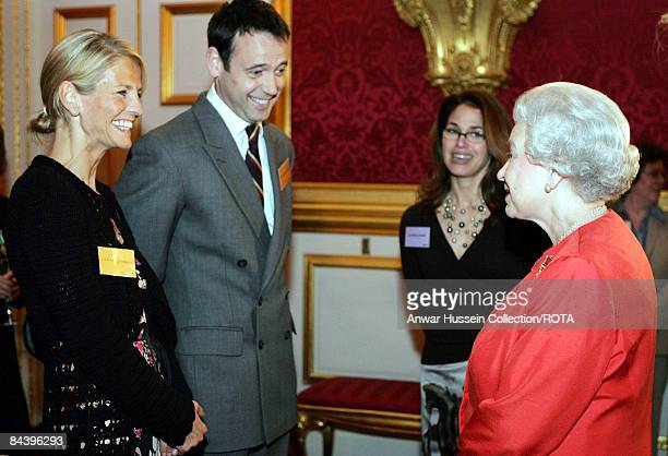 HM The Queen Elizabeth II meets Ulrika Jonsson and her husband Lance GerrardWright at a reception for the Women's Royal Voluntary Service at St...