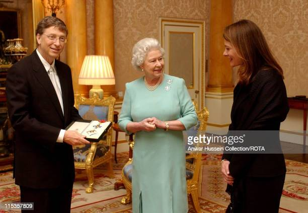 HM The Queen Elizabeth II presents Microsoft tycoon Bill Gates with his honorary knighthood at Buckingham Palace London Wednesday March 2 2005...