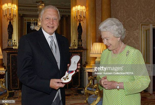 HM The Queen Elizabeth II presents TV naturalist Sir David Attenborough with the Insignia of the Order of Merit a personal award from the Queen...