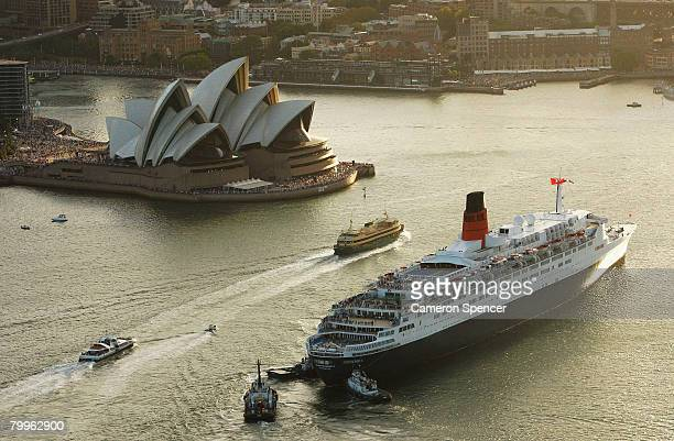 The Queen Elizabeth II ship heads to the Overseas Passenger terminal after a rendezvous with fellow Cunard luxury liner the Queen Victoria at Garden...