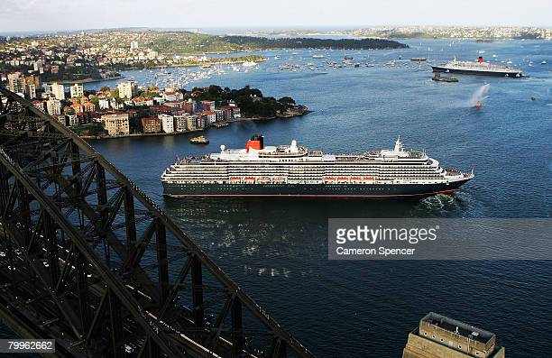 The Queen Elizabeth II ship passes fellow Cunard luxury liner the Queen Victoria at Garden Island in Sydney Harbour on their final and first voyages...