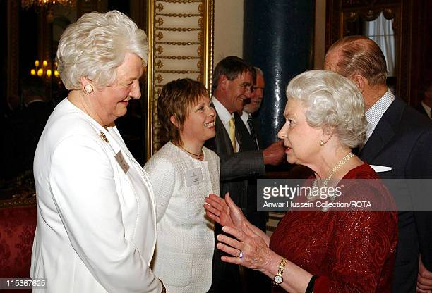 HM The Queen Elizabeth II talks to Dame Mary Peters who won a Gold Medal in the Pentathlon during the 1972 Munich Olympics as the Duke of Edinburgh...