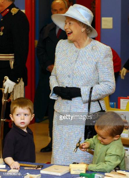 The Queen, Elizabeth II with the children of Rascals PlayStation, childcare facility at Ballinamallard, County Fermanagh, Northern Ireland, 14 May,...