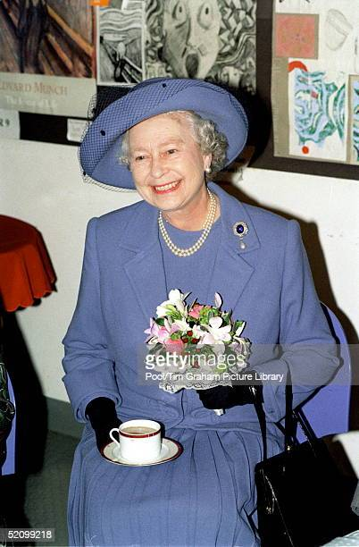 The Queen Enoying A Cup Of Tea During A Visit To The Grey Coat Hospital To Mark Its Tercentenary.