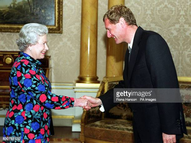 The Queen greets for the first time the newly appointed Poet Laureate Australian born Andrew Motion at Buckingham Palace London