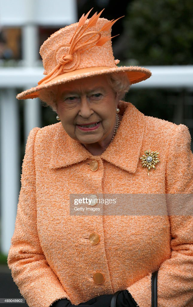 HM The Queen heads out to present the trophy to the owners of Solow after the Queen Elizabrth II Stakes Race run during the QIPCO British Champions Day at Ascot Racecourse on October 17, 2015 in Ascot, England.