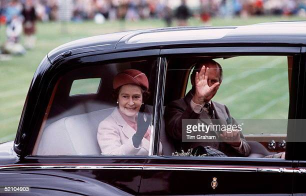 The Queen In Her Official Rolls Royce Car With Prince Philip Waving To The Crowds At The Braemar Games Which They Visit Every Year During Their...