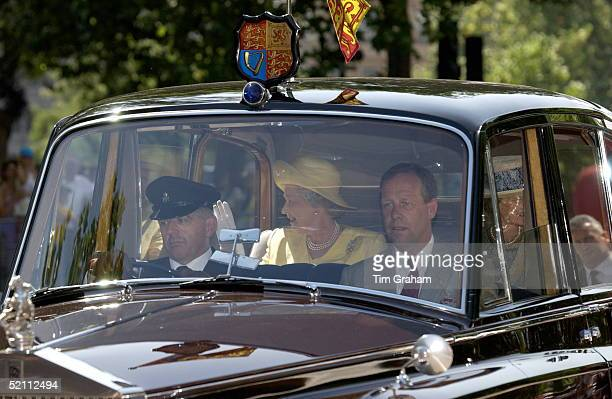 The Queen In Her Official Rolls Royce Car With The Royal Standard Plaque And Flag With Her Bodyguard Ken Atmore And Chauffeur In The Front She Is...
