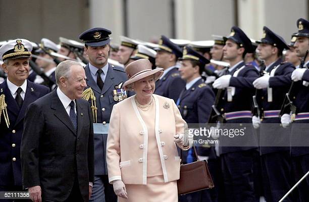 The Queen In Jolly Mood Inspecting A Guard Of Honour During The Arrival Ceremony At The Quirinale Palace In Romewalking With Her Is The President Of...