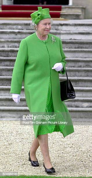 The Queen In The Gardens Of Buckingham Palace, London, Attending The First Of Her Annual Garden Parties.