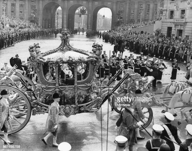 The Queen in the Gold State Coach passing through Trafalgar Square on her return from Westminster Abbey to Buckingham Palace following her...