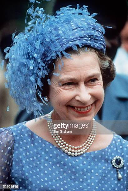 The Queen In The Solomon Isles During Her Official Tour Of The South Pacific Islands Wearing A Hat With Feathers Threestrand Pearl Necklace And The...