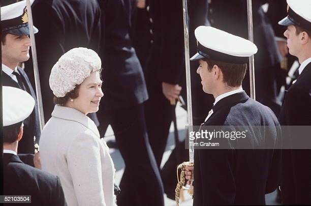 The Queen Inspecting The Passing Out Parade At The Dartmouth Royal Naval College She Is With Her Son Prince Andrew Who Is Taking Part In The Passing...