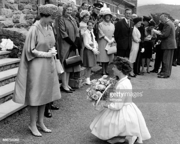 The Queen is presented with a bouquet of flowers at the UDC offices 10th August 1963