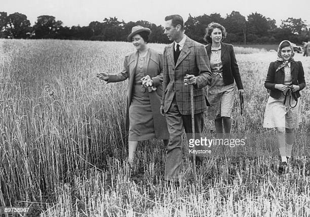 The Queen leads her family on a tour of Sandringham Park which has been turned over to agricultural production in aid of the war effort August 1943...