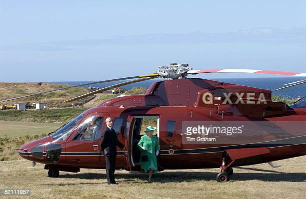 The Queen Leaving The Royal Flight Helicopter Sikorsky S76 During Her Royal Tour Of The Channel Islands
