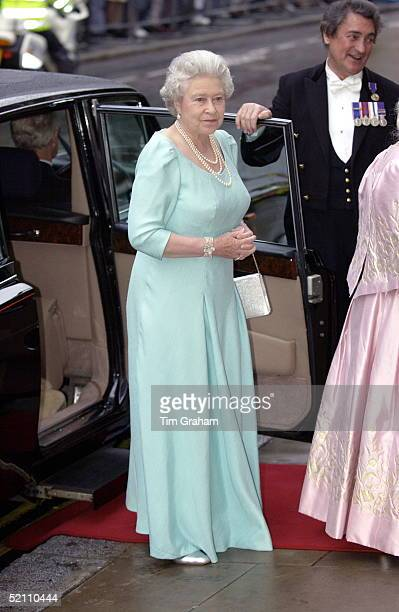 The Queen Looking Thoughtful And Bemused While Arriving At The Royal Opera House In Covent Garden For An Evening Out With Her Sister And Mother To...