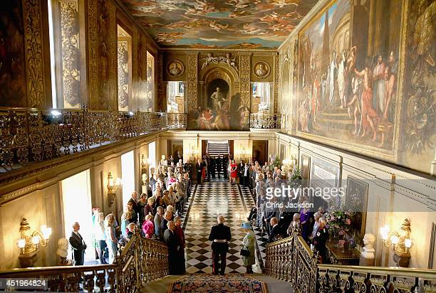 The Queen looks on with the Duke of Edinburgh as the Lord Lieutenant of Derbyshire William Tucker gives a short speech in the Painted Hall at...
