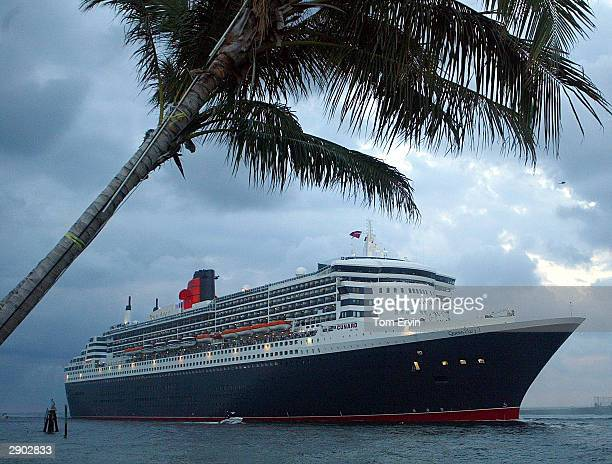 The Queen Mary 2, the largest luxury ocean liner ever built, arrives at the jetty at Port Everglades before sunrise following its maiden voyage from...
