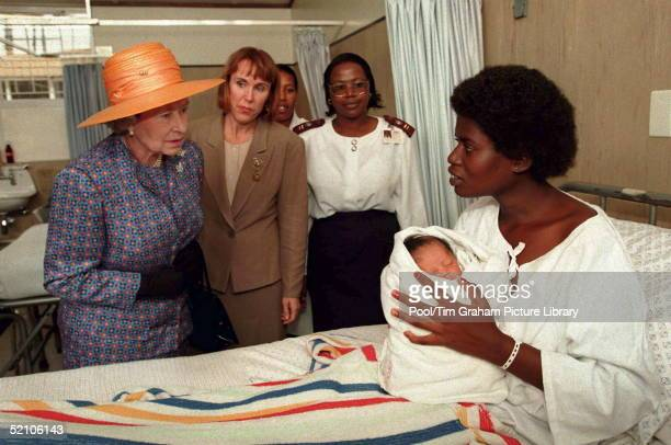 The Queen Meeting A Mother And Baby During Her Visit To The Baragwanath Hospital In Soweto South Africa