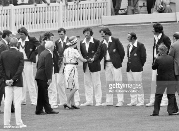 HM the Queen meets Dennis Lillee of Australia while being introduced to the Australian team by captain Ian Chappell and Gubby Allen during the 2nd...