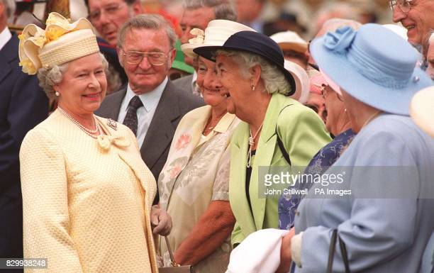 The Queen meets guests all couples celebrating 50 years of marriage at today's special Golden Wedding Anniversary Buckingham Palace garden party See...