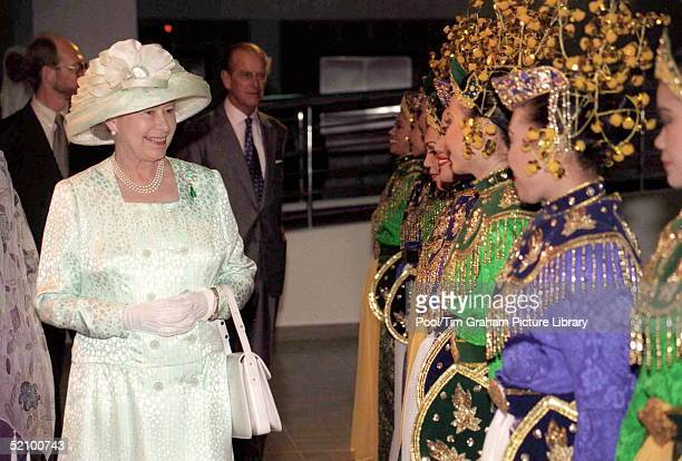 The Queen Meets Some Traditional Dancers At The Art Gallery, Kuala Lumpar.