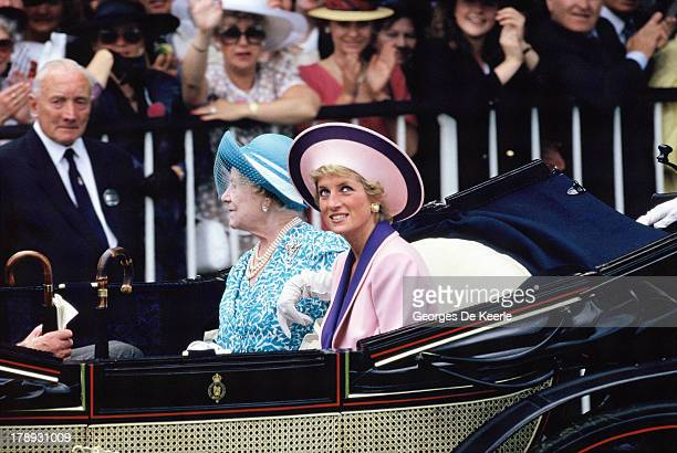 The Queen Mother and Diana Princess of Wales arrive at second day of Royal Ascot in an open carriage on June 20 1990 in Ascot England