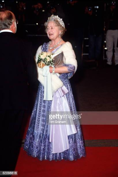 The Queen Mother At Film Premiere Of A Passage To India Wearing A Mauve Evening Dress And White Fur Stole Her Tiara Made By Boucheron Of Diamonds...